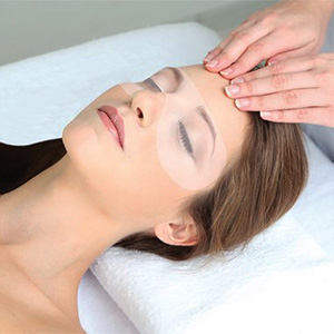 Female Client Getting an Eye Treatment in Los Angeles at Face of Jules LA Facial Spa