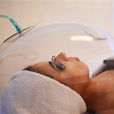 Client Getting Oxygen Dome Treatment at Face of Jules Los Angeles Facial Spa